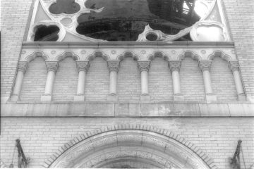 Blind terra cotta balustrade from above entrance.