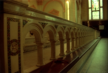Marble communion railing with inlaid glass mosaics.