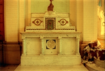 Left side marble altar with inlaid glass mosaics and bronze tabernacle.